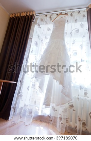 Picture of wedding white dress hanged - stock photo