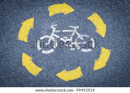 picture of white painted sign for bikes lane.