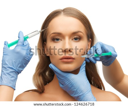 picture of woman face and beautician hands with syringe - stock photo
