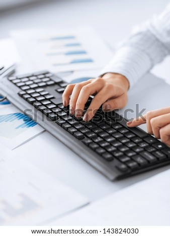 picture of woman hands typing on keyboard - stock photo