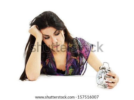 Picture of woman holding alarm clock.  Isolated on white background