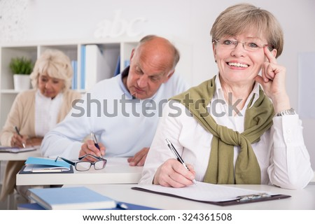 Picture of woman in her third age writing exam