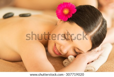 picture of woman in spa salon with hot stones - stock photo