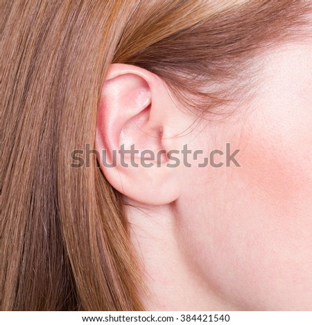 Picture of woman's ear close up - stock photo