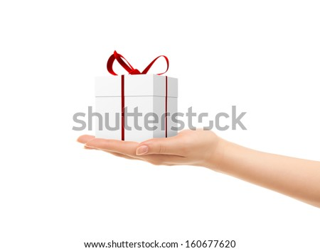 Picture of woman's hands holding a gift box isolated on white - stock photo