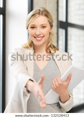 picture of woman with an open hand ready for handshake
