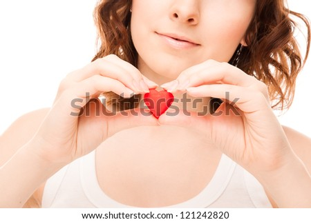 Picture of woman with candy heart isolated on white