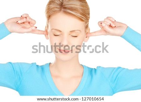 picture of woman with fingers in ears - stock photo