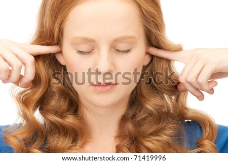 picture of woman with fingers in ears