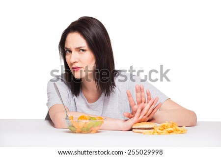 picture of woman with fruits rejecting hamburger - stock photo