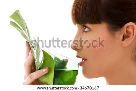 picture of woman with green leaf and glass of water - stock photo