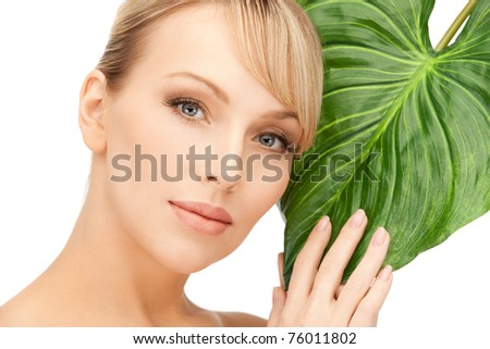 picture of woman with green leaf over white - stock photo