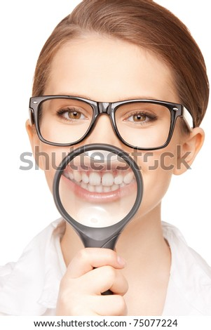 picture of woman with magnifying glass showing teeth - stock photo