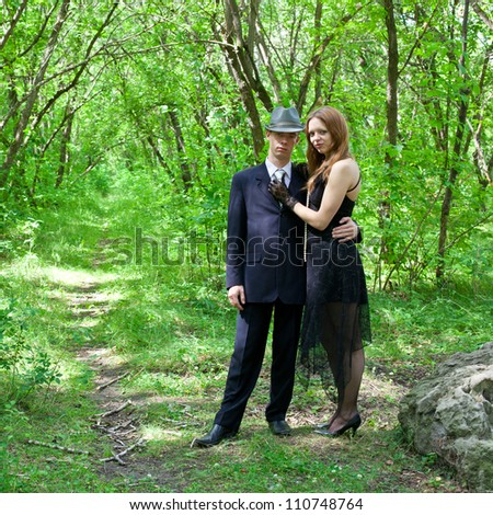Picture of young beautiful couple outdoors - stock photo