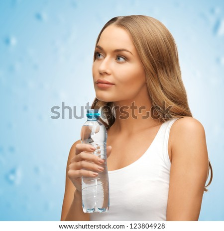 picture of young beautiful woman with bottle of water