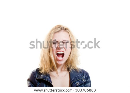 Picture of young blonde pretty woman emotionally screaming and looking at camera over light background copy space