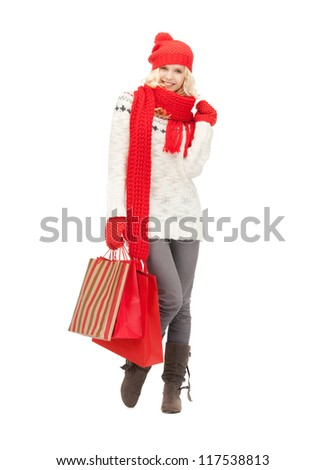picture of  young girl with shopping bags..