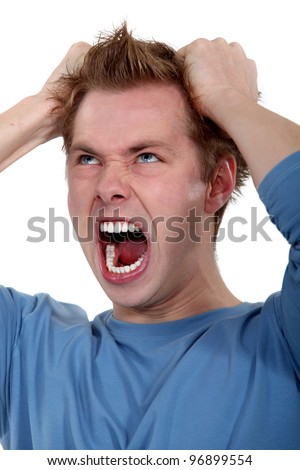 picture of young man going wild - stock photo