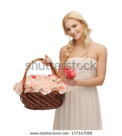picture of young woman with basket full of flowers.