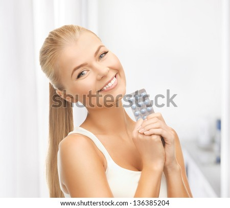 picture of young woman with one pack of pills - stock photo