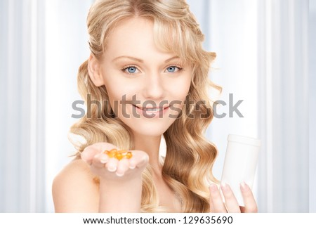 picture of young woman with pills - stock photo
