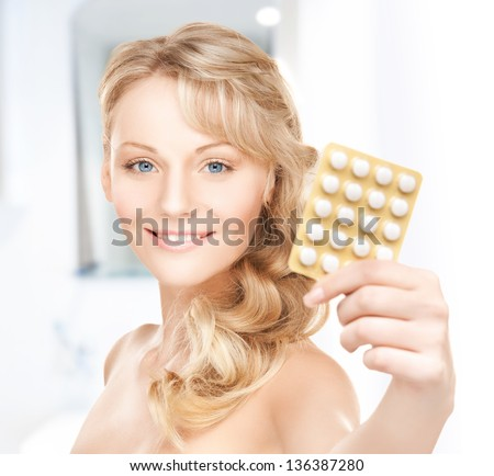 picture of young woman with pills at home - stock photo