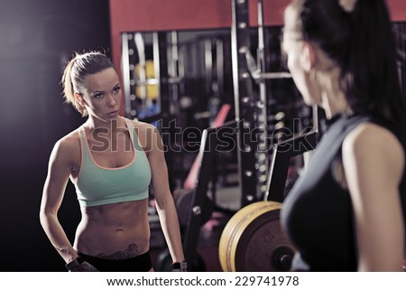 picture of young womans making exercise at the gym - stock photo