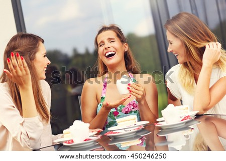 Picture presenting group of friends chatting in cafe - stock photo