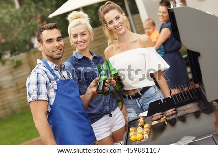 Picture presenting group of friends having barbecue party
