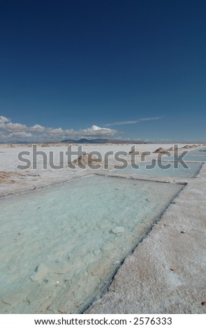 Picture showing a salt lake landscape, called Salinas Grande, near Argentina. This is where salt is exploited. vertical framing