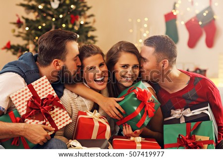 Picture showing group of friends celebrating Christmas at home