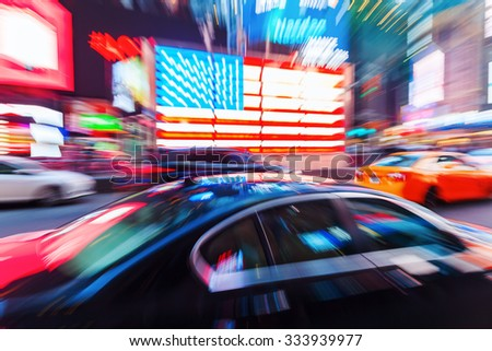 picture with camera made motion blur effect of traffic at night at Times Square, Manhattan, NYC