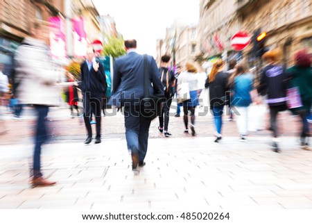 picture with creative zoom effect made by camera of a people crowd crossing a city street