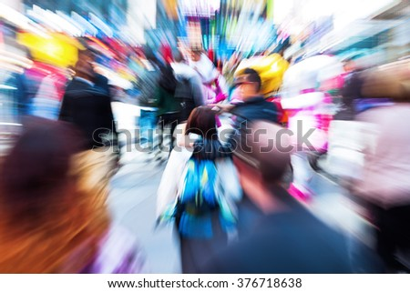 picture with creative zoom effect of a crowd of people on the move in the city - stock photo