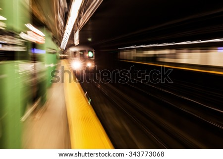 picture with creative zoom effect of a subway train at a subway station in NYC