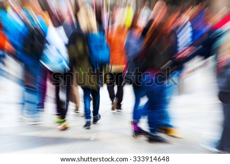 picture with creative zoom effect of crowds of people walking in the city