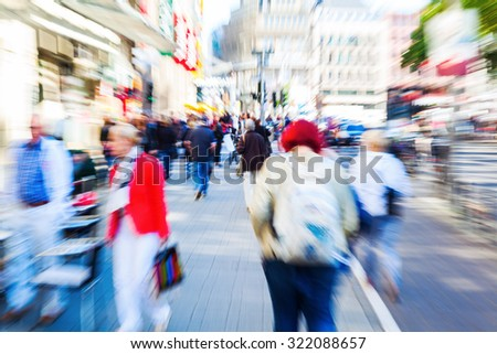 picture with creative zoom effect of people in a shopping street of a big city