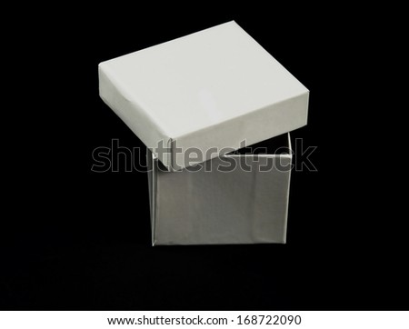 pictures of a square and white cardboard box - stock photo