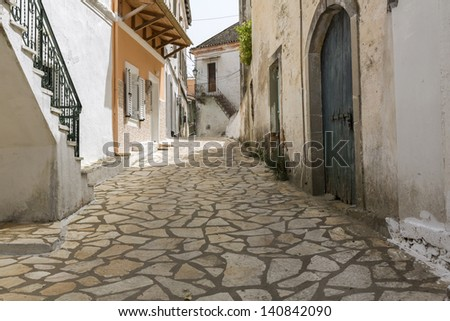 Picturesque alley in a mountain village on Corfu, Greece - stock photo