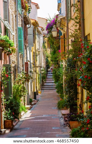 picturesque alley with entwined houses in Antibes, Cote Azur, France