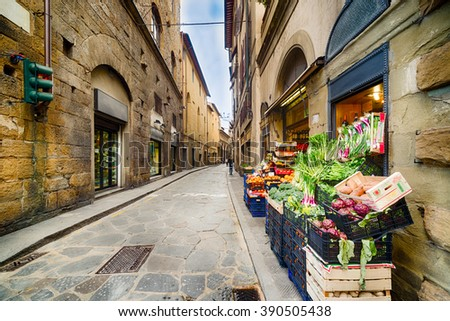 picturesque and typical street of Florence with boutiques and grocery stores - stock photo