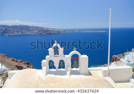 picturesque bell tower on the hillside of Santorini - stock photo