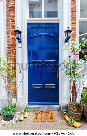 picturesque blue painted house door in Arnhem, Netherlands - stock photo
