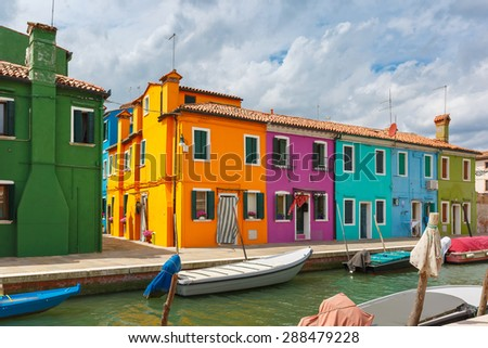 Picturesque canal with colorful houses on the famous island Burano, Venice, Italy - stock photo