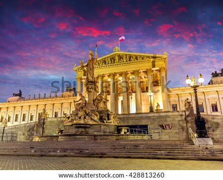 Picturesque cityscape of Austrian parliament building with famous Pallas Athena fountain. Dramatic spring  sunset in Vienna, Austria, Europe. Artistic style post processed photo. - stock photo