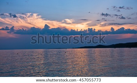 Picturesque cloudscape at sunset, west coast of peninsula Sithonia, Greece