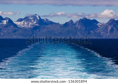 Picturesque coast of Lofoten islands in Norway seen from ferry - stock photo