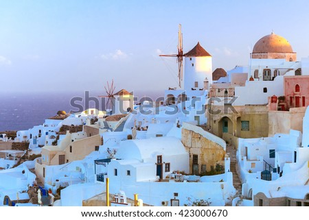 Picturesque famous view, Old Town of Oia or Ia on the island Santorini, white houses and windmills at dawn, Greece - stock photo