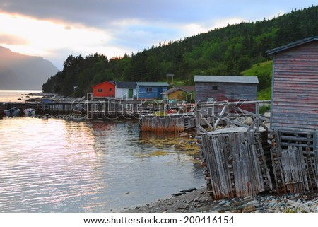 Picturesque fishing village during sunset in Nordic landscape - stock photo