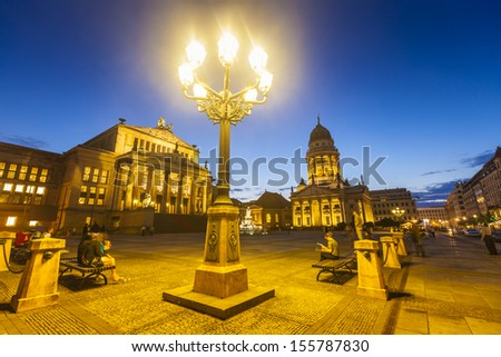Picturesque Gendarmenmarkt paved Neoclassical square popular with both Berliners and tourists. The Deutscher (1785) and the Franzosischer Dom (1701) reside in this beautiful area of Berlin. - stock photo